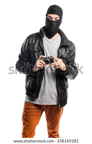 Robber photographing - stock photo
