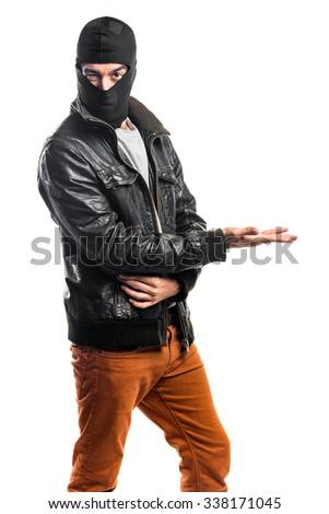 Robber presenting something - stock photo