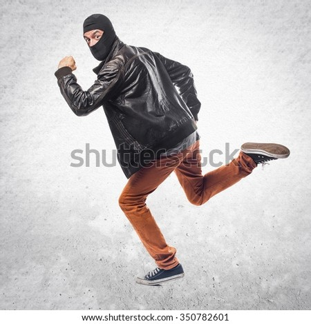 Robber running fast - stock photo