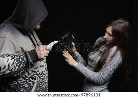Robber threatened the victim with knife - stock photo