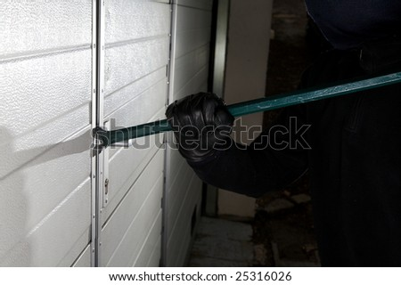 robber violation property against the door - stock photo