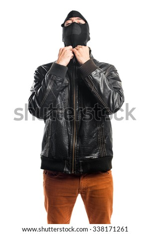 Robber wearing a leather jacket  - stock photo