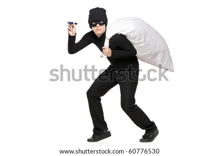 Robber with a bag and flashlight in hands isolated against white background - stock photo
