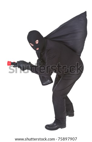 robber with flashlight and sack isolated on white