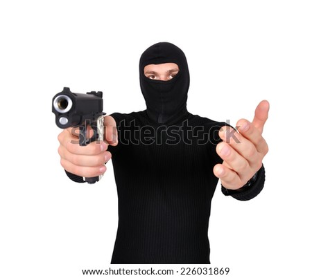 robber with gun in hand on a white background - stock photo