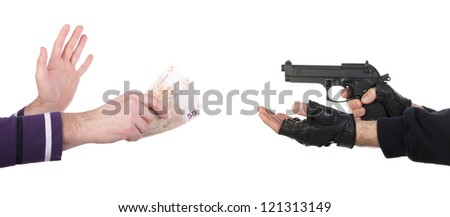 Robber with gun taking money from victim against a white background - stock photo