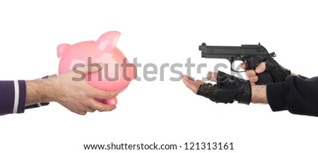 Robber with gun taking piggy bank from victim against a white background - stock photo