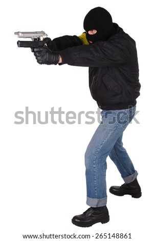 Robber with handgun isolated on white background - stock photo