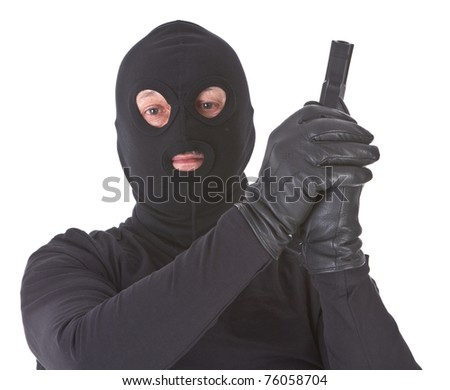 robber with his gun isolated on white background - stock photo