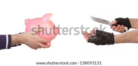 Robber with knife taking piggy bank from victim against a white background - stock photo