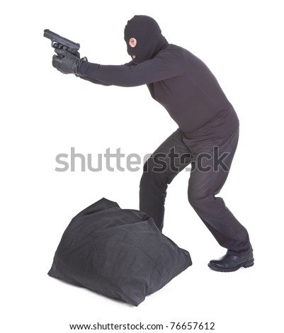 robber with sack aiming with his gun isolated on white background - stock photo