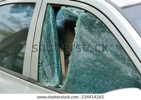robbery broken car windshield  - stock photo