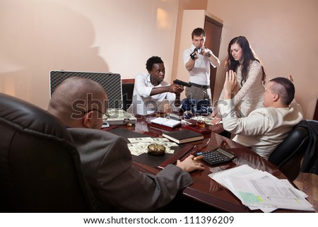 Robbery in the office.  Case of dollars on the background. - stock photo
