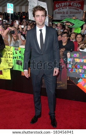 Robert Pattinson, wearing a Gucci suit, at THE TWILIGHT SAGA NEW MOON Premiere, Mann Village and Bruin Theaters, Los Angeles, CA November 16, 2009  - stock photo