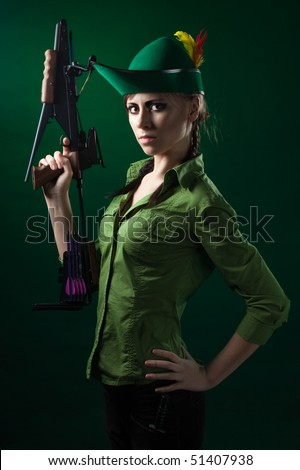 Robin hood style woman hold crossbow ready to fight