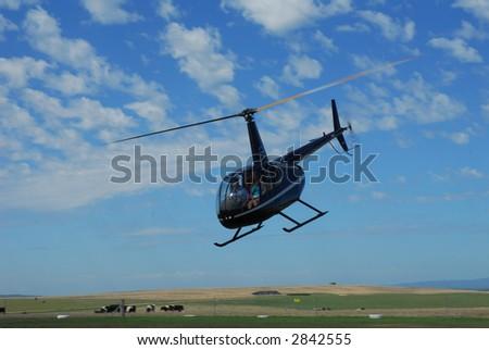 Robinson R44 Helicopter - Australia - stock photo