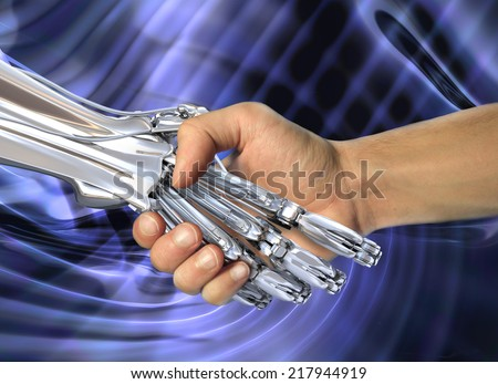 Robot and human handshake.  Friendship between high technology and people - stock photo