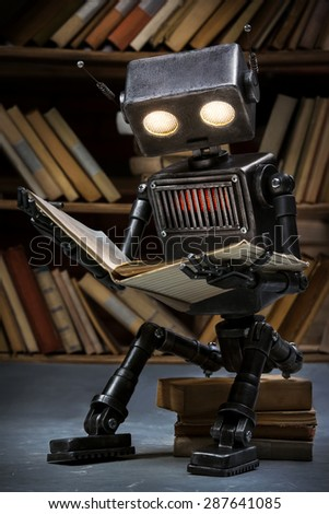 Robot-child reading a book in the library of its creator - stock photo