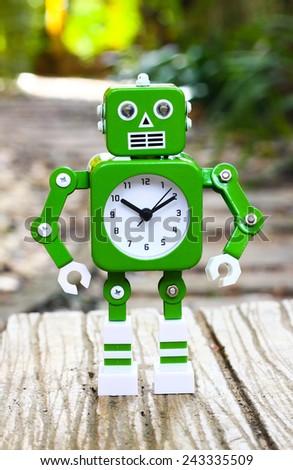 robot clock in outdoor garden - stock photo