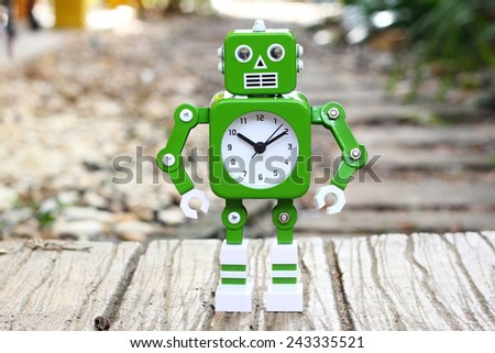 robot clock in outdoor garden - stock photo