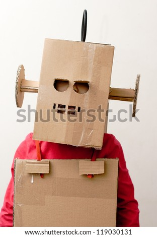 Robot Girl. Little girl with a cardboard box on his head. - stock photo
