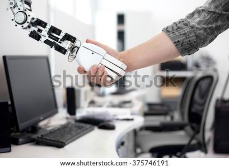 Robot man handshake - stock photo