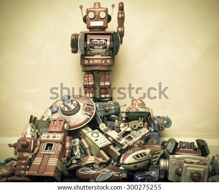 robot toy stands on the oppressed - stock photo