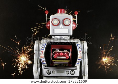 robot toy with sparks - stock photo
