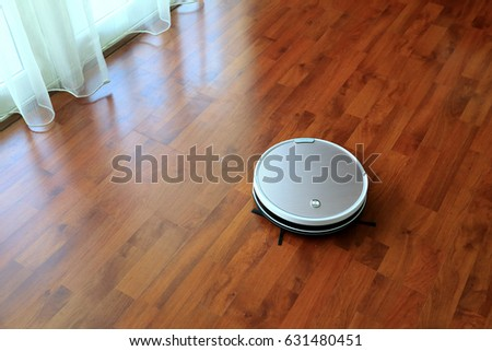Robot Vacuum Cleaner On Laminate Wood Stock Photo Royalty Free