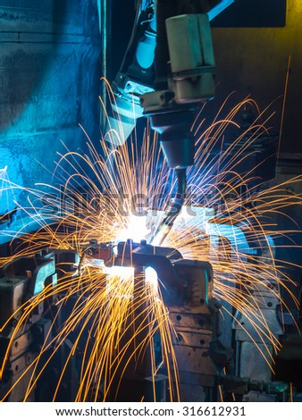 Robot welding movement Industrial  automotive part in factory  - stock photo