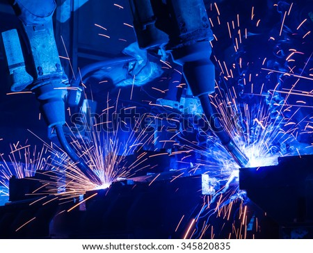 Robot welding movement Industrial automotive part in factory - stock photo