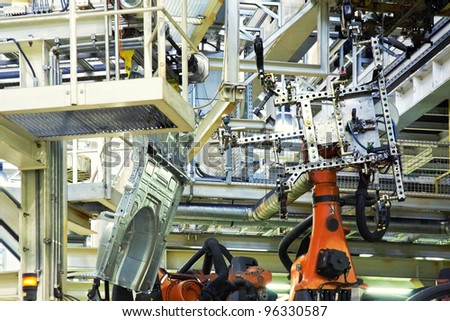 robotic arms in a car factory - stock photo