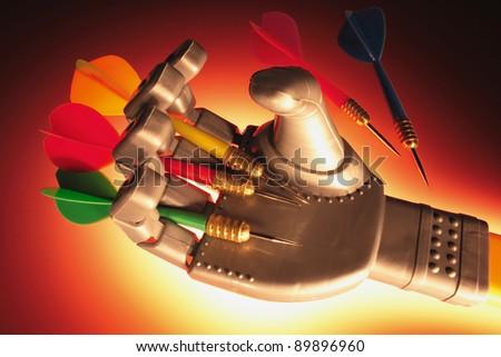 Robotic Hand Holding Darts with Warm Glow - stock photo