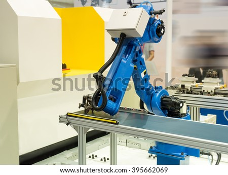 robotic hand machine tool at industrial manufacture factory - stock photo
