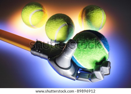 Robotic Hand with Tennis Balls with Warm and Blue Glows - stock photo