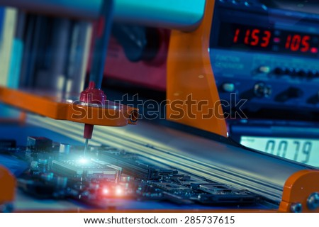 robotic system for automatic checking of printed circuit boards - stock photo