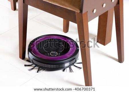 robotic vacuum cleaner on the floor - stock photo