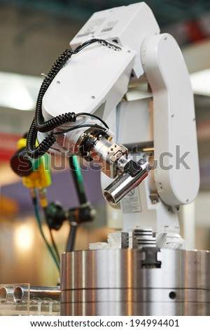 Robotics. Mechanical precision arm of robot manipulator with detail during positioning at facory - stock photo