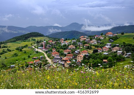 Rochleva village is located on the green slopes of Rhodope Mountain. Bulgaria - stock photo