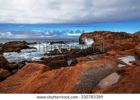 Rock and colorful unusual geological formations at low tide, along the rugged Big Sur coastline, near Monterey, CA. on the California Central Coast - stock photo