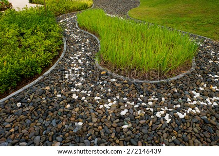 Rock and rice in a Lush Tropical Garden  - stock photo