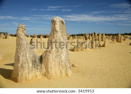 Rock and sand formations next to the sea and desert - stock photo