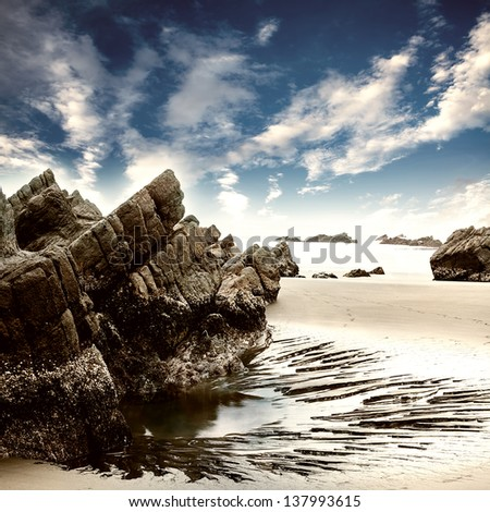Rock and sea with sunset - stock photo