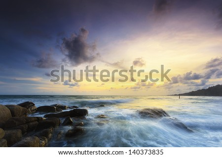 Rock and seascape at sunset time - stock photo