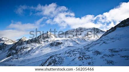 Rock and snow in Switzerland Alps - stock photo