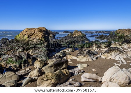 Rock and unusual geological formations at low tide, along the rugged Big Sur coastline, near Monterey, CA. on the California Central Coast - stock photo