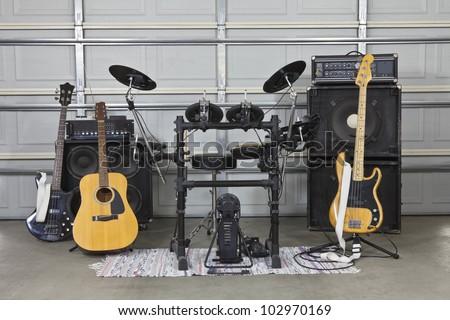 Rock band equipment in a suburban garage. - stock photo