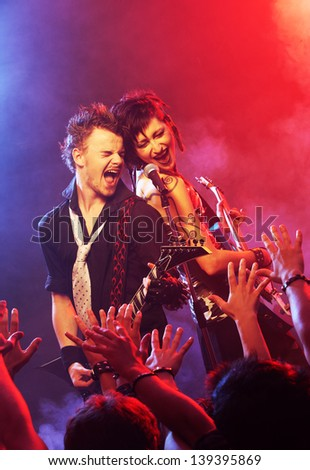 Rock band live. Band on Stage performing for his adoring fans - stock photo