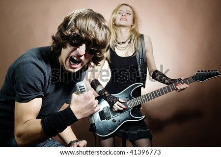 Rock band:  man and woman during concert. - stock photo