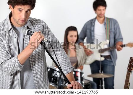 Rock band rehearsing - stock photo